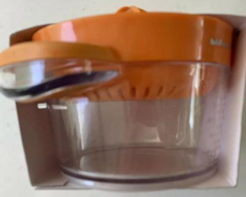 Kitchen Aid orange lid, holds